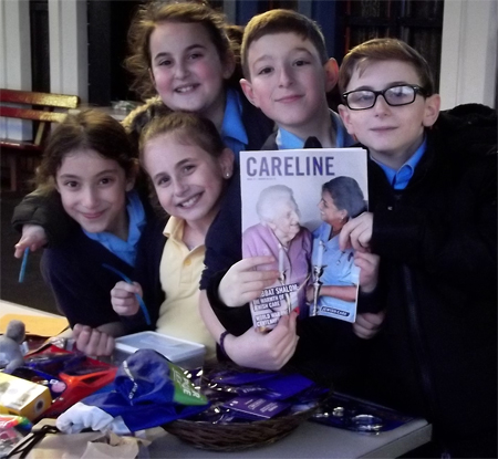 Sinai School Pupil Roni Berman with his friends at the stall raising money for Jewish Care