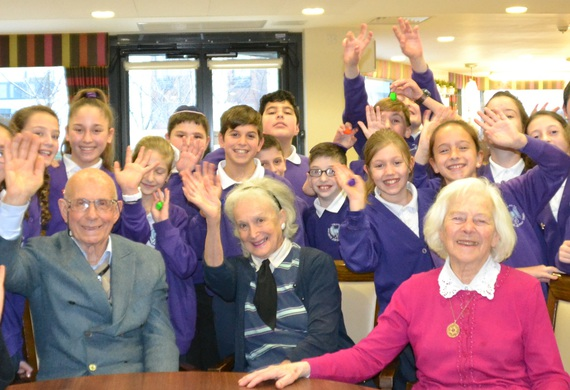Hjps year 6 pupils sing to and meet colin pulvernis  trudie bluestone and rita temple members of jewish care michael sobell community centre listing