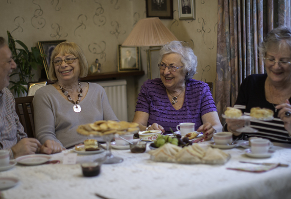 Guests enjoying a jewish care supportive communities tea party listing