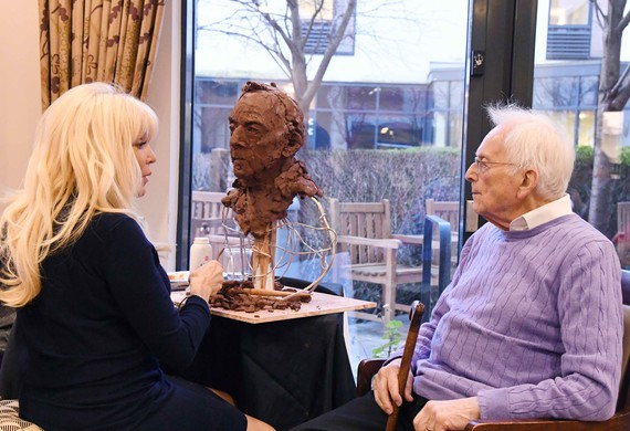 Frances Segelman at Jewish Care's Selig Court sculpting Freddie Knolller Jewish Care's Holocaust Survivors' Centre member.