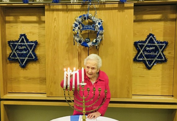 Dorothea jacobs lights the menorah for chanukah at jewish care's otto schiff home listing