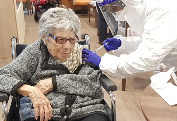 Cropped landscape resident marion phillips 95 at anita dorfman house recieving covid 19 vaccine listing