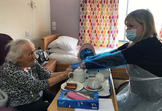 Jewish care resident nina doltis holds hands with her daughter jacky listing